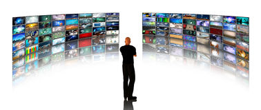 Man viewing video displays Royalty Free Stock Photos