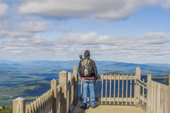 Man on viewpoint admiring landscape Royalty Free Stock Images