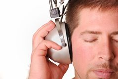 Man with vintage headphones. Over white background Stock Images