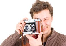 Man with vintage photo camera Stock Images