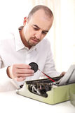 Man with vintage typewriter Royalty Free Stock Images