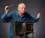 Man with vintage wooden photo camera Stock Photography