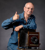 Man with vintage wooden photo camera Stock Photo