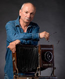 Man with vintage wooden photo camera Stock Image