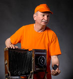 Man with vintage wooden photo camera Stock Images