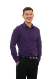 Man in violet shirt and trousers Stock Photo