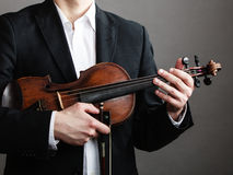 Man violinist holding violin. Classical music art Royalty Free Stock Photos