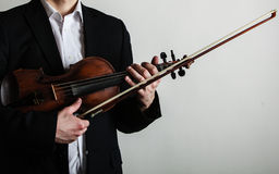 Man violinist holding violin. Classical music art Stock Image