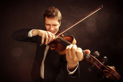 Man violinist playing violin. Classical music art Royalty Free Stock Photography