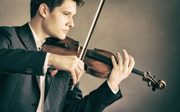 Man violinist playing violin. Classical music art Stock Image
