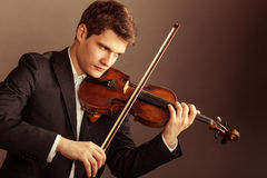 Man violinist playing violin. Classical music art stock photography