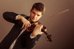Man violinist playing violin. Classical music art Stock Photos