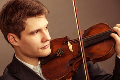 Man violinist playing violin. Classical music art Royalty Free Stock Image