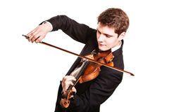Man violinist playing violin. Classical music art Stock Photo