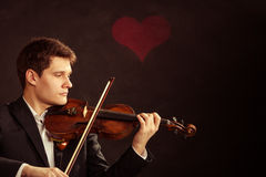 Man violinist playing violin. Classical music art Royalty Free Stock Photo