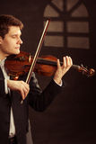Man violinist playing violin. Classical music art royalty free stock photos