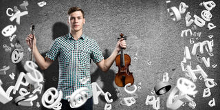 Man violinist. Young man in casual on cement background playing violin Stock Photos