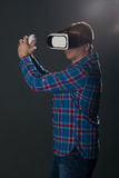 Man with virtual glasses are swordplay Stock Images