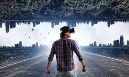 Man in virtual helmet . Mixed media Stock Photos