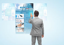 Man with virtual projection of business news Royalty Free Stock Images