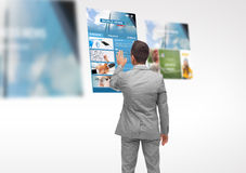 Man with virtual projection of business news Stock Photography