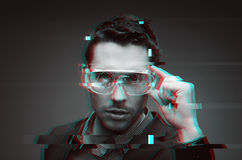 Man in virtual reality or 3d glasses with glitch Stock Photos