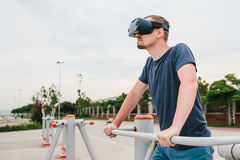 A man in virtual reality glasses is doing sports. Future technology concept. Modern imaging technology. Classes in. The man with glasses of virtual reality Royalty Free Stock Photos