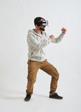 Man in virtual reality glasses in fighting pose Stock Photography