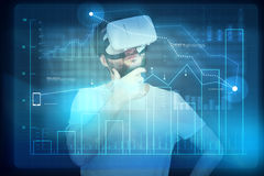 Man in virtual reality glasses looking at the digital display wi Royalty Free Stock Image