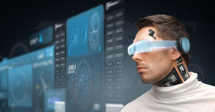 Man in virtual reality glasses and microchip Royalty Free Stock Photos