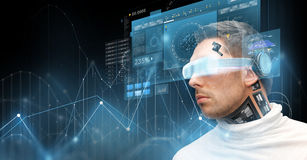 Man in virtual reality glasses and microchip Royalty Free Stock Images