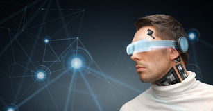Man in virtual reality glasses and microchip. Augmented reality, technology, business, future and people concept - man in virtual glasses and microchip implant Royalty Free Stock Images