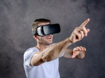 Man with virtual reality glasses pointing upward Stock Image