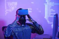 Man in virtual reality glasses working at office stock images
