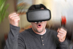 Man with virtual reality goggles is playing 3D games Stock Photography