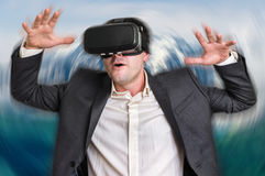 Man with virtual reality goggles is playing 3D games Royalty Free Stock Photos