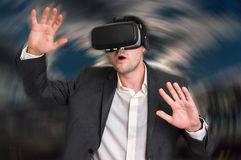Man with virtual reality goggles is playing 3D games Royalty Free Stock Images