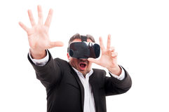 Man with virtual reality goggles in scary action Stock Image