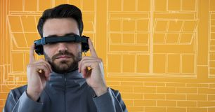 Man in virtual reality headset against orange and white hand drawn window Royalty Free Stock Image