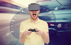Man in virtual reality headset and car racing game Royalty Free Stock Image