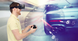 Man in virtual reality headset and car racing game Royalty Free Stock Photos