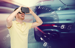 Man in virtual reality headset and car racing game Royalty Free Stock Photography