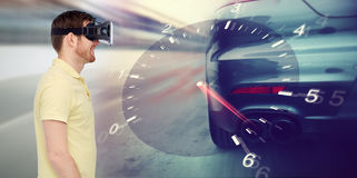Man in virtual reality headset and car racing game Stock Photos