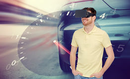 Man in virtual reality headset and car racing game Stock Image