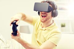 Man in virtual reality headset with controller Stock Photos