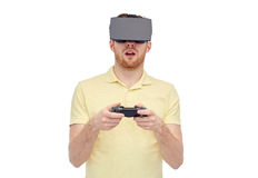 Man in virtual reality headset or 3d glasses Stock Photo