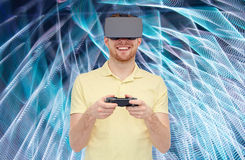 Man in virtual reality headset or 3d glasses Stock Photography