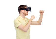 Man in virtual reality headset or 3d glasses Stock Image