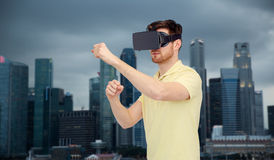 Man in virtual reality headset or 3d glasses Royalty Free Stock Image