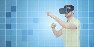 Man in virtual reality headset or 3d glasses. 3d technology, virtual reality, entertainment and people concept - young man with virtual reality headset or 3d Stock Photography